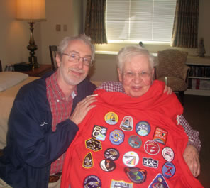 Photo of brother holding hoodie of NASA patches up to Dad